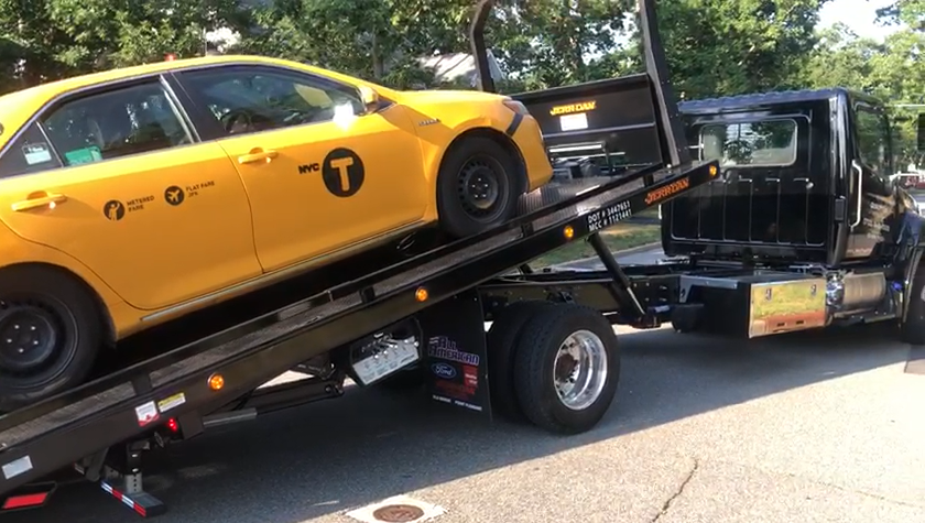 Taxi on tow truck